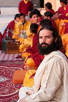 India, Rishikesh.  Worshipper at Evening Prayer (Aarti) at Parmarth Niketan Ashram.