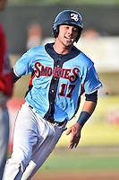 Tennessee Smokies third baseman Kris Bryant #17 runs to third during a game against the Birmingham Barons at Smokies Park on May 31, 2014 in Kodak, Tennessee. The Barons defeated the Smokies 2-1. (Tony Farlow/Four Seam Images)
