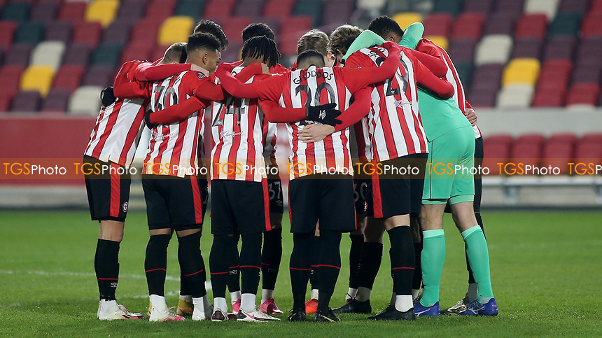 Brentford players form a huddle ahead of kick-off during Brentford vs Middlesbrough, Emirates FA Cup Football at the Brentford Community Stadium on 9th January 2021