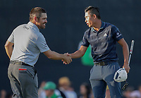 17th July 2021; Royal St Georges Golf Club, Sandwich, Kent, England; The Open Championship Golf, Day Three; Louis Oosthuizen (RSA) and Collin Morikawa (USA) shake hands on the 18th green