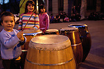 All-female Candombe comparsa La Melaza during a practice session in the neighborhood of Palermo in Montevideo, Uruguay.  The group is joined by friends and neighbors every Sunday and Wednesday night for drinking and dancing as they drum through the streets.