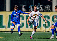 26 October 2019: University of Vermont Catamount Forward Rasmus Tobinski, a Freshman from Kiel, Germany, keeps the ball away from University of Massachusetts Lowell River Hawk Backfielder German Fuentes, a Sophomore from Joroco, El Salvador, in first half action at Virtue Field in Burlington, Vermont. The Catamounts rallied to defeat the River Hawks 2-1, propelling the Cats to the America East Division 1 conference playoffs. Mandatory Credit: Ed Wolfstein Photo *** RAW (NEF) Image File Available ***
