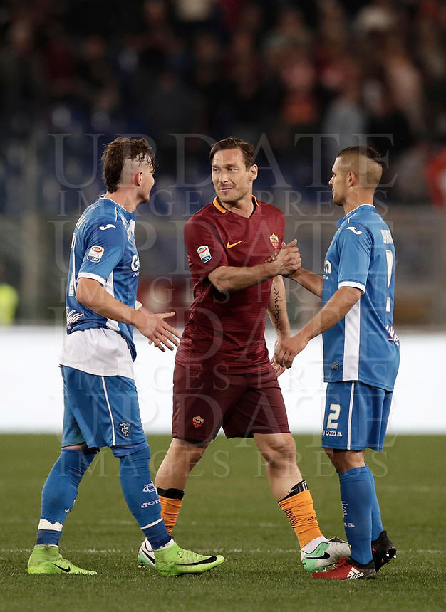 Calcio, Serie A: Roma, stadio Olimpico, 1 aprile, 2017.<br /> Roma's Francesco Totti (c) greets Empoli's Vincent Laurini (r) and Marcel Buchel (l) at the end of the Italian Serie A football match between Roma and Empoli at Olimpico stadium, April 1, 2017<br /> UPDATE IMAGES PRESS/Isabella Bonotto