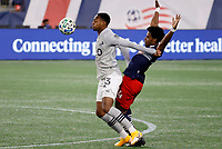 20th November 2020; Foxborough, MA, USA;  Montreal Impact forward Mason Toye fends off New England Revolution midfielder DeJuan Jones during the MLS Cup Play-In game between the New England Revolution and the Montreal Impact