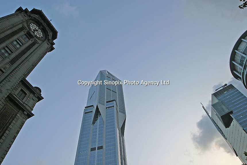 A super modern tower and an old museum in Shanghai, China.  Daily life is changing drastically for thousands in China as old neighborhoods are torn down to make way for new, modern structures..
