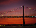Retro Image of San Francisco downtown old Oakland Bay bridge at sunrise with street lights and bridge lights, San Francisco, California USA