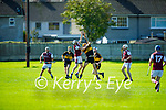 Causeway's Mark Dillane and Anthony Keogh of Dr Crokes take to the air for possession, in the 2021 Junior Hurling Championship final