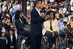 December 9, 2007. Columbia, SC.. Democratic presidential hopeful and US Senator, Barack Obama held a rally for an estimated 29,000 people at the University of South Carolina's football stadium with special guest Oprah Winfrey.. Barack Obama speaks as Michelle and Oprah look on..