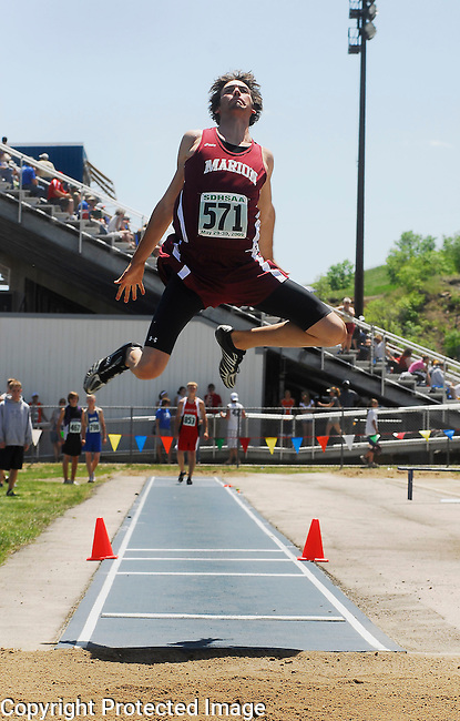 Inertia Photo/Dick Kettlewell:  Marion's Broderick Schmidt takes a first place in this heat of the triple jump.