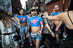 © Joel Goodman - 07973 332324 - all rights reserved . 25/08/2019. Manchester, UK. Three men wearing crop top Superman t-shirts outside the Molly House pub . Revellers in Manchester's Gay Village during the city's annual Gay Pride festival , which celebrates LGBTQ+ life and is the largest of its type in Europe . Photo credit : Joel Goodman