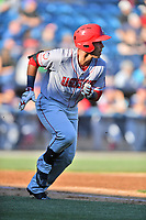 Hagerstown Suns designated hitter Oliver Ortiz (8) runs to first base during a game against the  Asheville Tourists at McCormick Field on May 13, 2017 in Asheville, North Carolina. The Suns defeated the Tourists 9-5. (Tony Farlow/Four Seam Images)