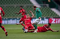 18th May 2020, WESERSTADION, Bremen, Germany; Bundesliga football, Werder Bremen versus Bayer Leverkusen;   Philipp Bargfrede Werder Bremen is slide tacked by Florian Wirtz Leverkusen