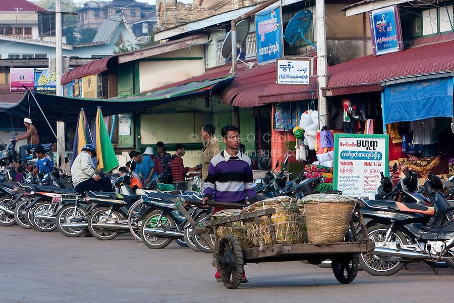 Myanmar, Burma.  Kalaw Street Scene.  Vendor Pushing Cart.