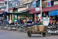 Myanmar, Burma.  Kalaw Street Scene.  Vendor Pushing Cart.