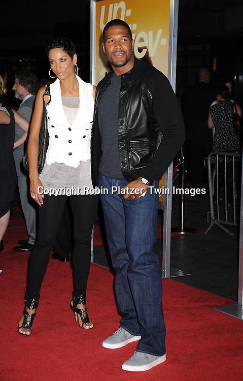 Nicole Murphy and Michael Strahan