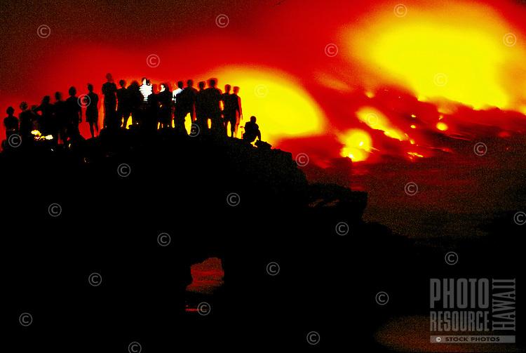 Spectators watch as new lava flows to the sea from Kilauea volcano, Hawaii volcanoes national park, Big Island