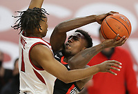 Arkansas guard JD Notae (1) blocks Georgia Tye Fagan (14) Saturday, January 9, 2021 during the second half of a basketball game at Bud Walton Arena in Fayetteville. Check out nwaonline.com/210110Daily/ for today's photo gallery. <br /> (NWA Democrat-Gazette/Charlie Kaijo)