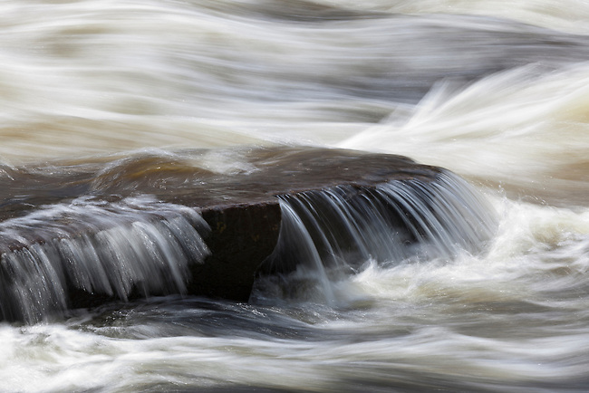 Buttermilk Falls near Long Lake, NY in the Adirondacks had very high water in early April, and this closeup of a single rock captured a beautiful view of the flow.