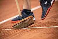 29th September 2020, Roland Garros, Paris, France; French Open tennis, Roland Garros 2020;  A Roland Garros groundsman cleaning the lines of the court during the match between Laura SIEGEMUND GER and Kristina MLADENOVIC FRA in the Philippe Chatrier court on the first round of the French Open