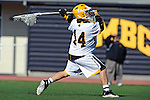 Baltimore, MD - March 3: Goalkeeper Adam Cohen #14 of the UMBC Retrievers clears the ball up field  during the Fairfield v UMBC mens lacrosse game at UMBC Stadium on March 3, 2012 in Baltimore, MD.