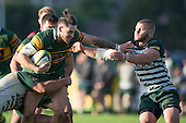 Jared Page fends off Brandon Mahi as he tries to break free from the tackle. Counties Manukau Premier Club Rugby game between Pukekohe and Manurewa, played at Colin Lawrie Fields, Pukekohe, on Saturday May 28th, 2016. Pukekohe won the game 62 - 18 after leading 19 - 10 at halftime. Photo by Richard Spranger.