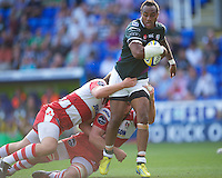 Sailosi Tagicakibau of London Irish is tackled  during the Aviva Premiership match between London Irish and Gloucester Rugby at the Madejski Stadium on Saturday 8th September 2012 (Photo by Rob Munro)