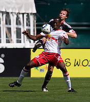 Carey Talley (8) of D.C. United tries to clear the ball away from Salou Ibrahim (29) of the New York Red Bulls at RFK Stadium in Washington, DC.  The New York Red Bulls defeated D.CC United, 2-0.