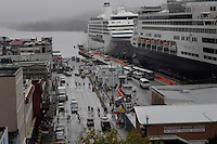 Cruise ships arrive in Ketchikan to deposit shoppers and sightseers into the rainy city for the afternoon.  As many as six ships can add upwards of 9,000 people to the small town of 17,000.  Jewelry stores dominate the Front Street, most of which are owned by the cruise ships.  There are about 68 shops in town all vying for tourist dollars with diamonds and jewels,  Most close in the winter enabling their Pakistani workers to take business south.  Ketchikan was once a logging town, but has turned to tourism.