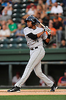 Left fielder Rafael Rodriguez (14) of the Augusta GreenJackets in a game against the Greenville Drive on Thursday, May 22, 2014, at Fluor Field at the West End in Greenville, South Carolina. Greenville won, 7-2. (Tom Priddy/Four Seam Images)