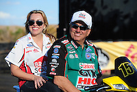 Feb. 19, 2012; Chandler, AZ, USA; NHRA funny car driver John Force (right) with daughter Brittany Force during the Arizona Nationals at Firebird International Raceway. Mandatory Credit: Mark J. Rebilas-