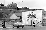 Derry Northern Ireland Londonderry. 1979. You Are Now Entering Free Derry, wall mural. Police RUC command posts looks down on the Bogside. Know as Free Derry Corner, situated at the junction of Fahan Street & Rossville Street.
