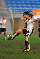 Lauren Cheney and Germany's #15 strike the ball midair in unison. The USA captured the 2010 Algarve Cup title by defeating Germany 3-2, at Estadio Algarve on March 3, 2010.