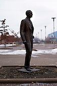 "Dearborn, Michigan<br /> USA<br /> February 17, 2011<br /> <br /> A statue of Henry Ford stands outside the former Ford Rouge Steel Plant. The plant was completed in 1928 is now owned, run and being renovated and expanded by Russian owner ""Severstal North America"". This is one of five steel plants owned by Severstal in the United States and they are spending huge sums to convert it into what could be the continent's most efficient automotive steel plant.<br /> <br /> Rouge Steel fell on hard times after Ford Motor Company spun it off in 1989 into an independent steel company. <br /> <br /> After buying the assets of the bankrupt company for USD 280 million, Severstal spent USD 350 million to repair one of the blast furnaces. The company built a new cold-rolling line which converts steel slabs into sheet metal. And it added a galvanizing line which coats sheet metal with zinc for rust-resistant body panels.<br /> <br /> The operation assets and improvements amount to USD 1.4 billion. Add in spending on a new mini mill in Columbus, Mississippi a USD 1.6 billion operation and Severstal has placed a USD 3 billion bet on North America auto industry."