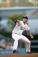 Los Angeles Dodgers pitcher Clayton Kershaw #22 pitches against the Colorado Rockies at Dodger Stadium on July 26, 2011 in Los Angeles,California. Los Angeles defeated Colorado 3-2.(Larry Goren/Four Seam Images)