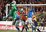 Dundee United v St Johnstone...12.03.14    SPFL<br /> Radoslaw Cierzniak gets the better of Steven Anderson<br /> Picture by Graeme Hart.<br /> Copyright Perthshire Picture Agency<br /> Tel: 01738 623350  Mobile: 07990 594431