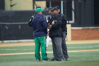 Home plate umpire Gregory Street (right) explains a call to Notre Dame Fighting Irish head coach Mik Aoki during the game against the Wake Forest Demon Deacons at David F. Couch Ballpark on March 10, 2019 in  Winston-Salem, North Carolina. The Demon Deacons defeated the Fighting Irish 7-4 in game one of a double-header.  (Brian Westerholt/Four Seam Images)