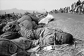 Goma, Zaire<br /> July 1994<br /> <br /> The dead bodies of fleeing Hutus pilled up along the roadsides. Both former military and civilians, died in epidemics of cholera and dysentery that swept the roads and refugee camps in Zaire.<br /> <br /> Following the 1994 Rwandan Genocide, in which Hutu militia groups and the Hutu lead Rwanda military, killed an estimated 800,000 ethnic Tutsis and sympathizers during a 100-day killing spree, 2 million ethnic Hutu?s, fearing reprisals, flee the country. The vast majority went to Goma, Zaire. People who had actively participated in the genocide hid among the refugees, fueling the First and Second Congo Wars.<br /> <br /> The international community, and the United Nations in particular, drew severe criticism for its inaction in the wake of the Rwandan Genocide.