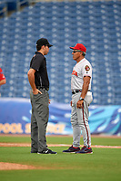Florida Fire Frogs manager Luis Salazar (4) gets an explanation on a call from field umpire Emil Jimenez during a game against the Clearwater Threshers on June 1, 2018 at Spectrum Field in Clearwater, Florida.  Florida defeated Clearwater 12-10.  (Mike Janes/Four Seam Images)