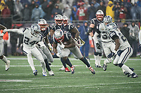FOXBOROUGH, MA - NOVEMBER 24: Dallas Cowboys Cornerback Chidobe Awuzie #24 and Dallas Cowboys Safety Xavier Woods #25 converge to tackle New England Patriots Runningback Sony Michel #26 during a game between Dallas Cowboys and New England Patriots at Gillettes on November 24, 2019 in Foxborough, Massachusetts.