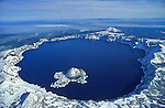 Wizard Island and Crater Lake in winter snow; Crater Lake National Park, Oregon..#2355-0128