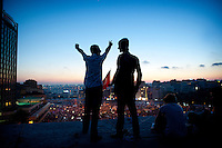 Copyright : Magali Corouge /Documentography<br />Istanbul, Turkey, the 9th of June 2013.<br /><br />Two men on a rooftop of a building in front of Taqsim Square, Istanbul.