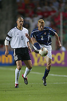 Frankie Hejduk traps the ball as Christian Ziege closes in. The USA lost to Germany 1-0 in the Quarterfinals of the FIFA World Cup 2002 in South Korea on June 21, 2002.