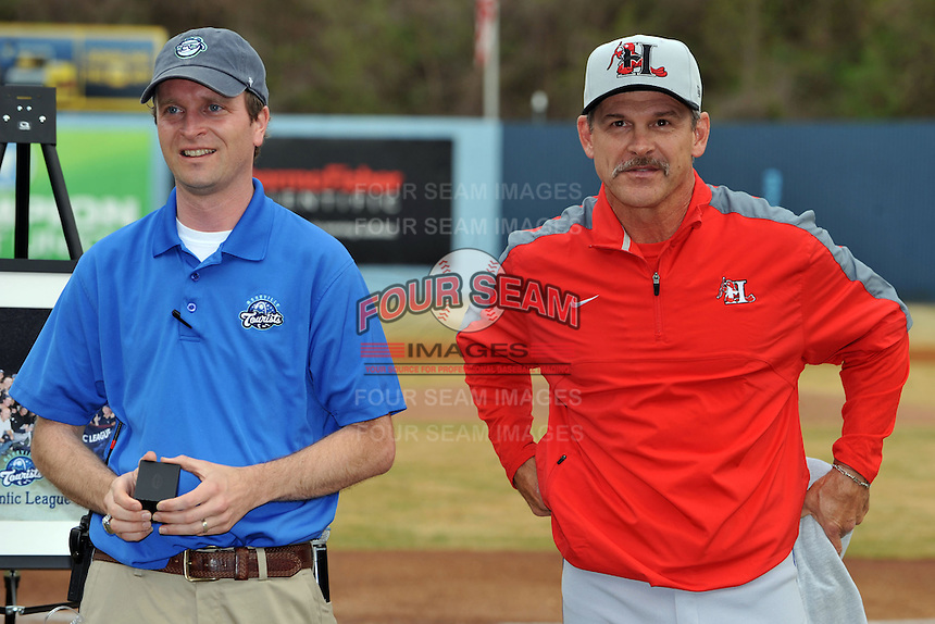 Former Asheville Tourists manager and current Texas Rangers roving instructor Joe Mikulik with Tourists President Brian DeWine prior to Joe being presented his 2012 Sally League championship ring before a game between the Hickory Crawdadsand the Asheville Tourists at McCormick Field on April 17, 2013 in Asheville, North Carolina. The Crawdads won the game 6-5. (Tony Farlow/Four Seam Images).