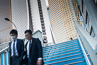 Businessmen in the Shinjiku area of Tokyo, Japan.<br /> March-2015