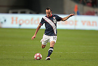 Landon Donovan takes a free kick. .The USA men fell to the Netherlands 2-1 at Amsterdam ArenA, Wednesday, March 3, 2010.