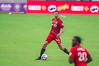 ORLANDO, FL - APRIL 24: Omar Gonzálex #44 of Toronto FC dribbles the ball during a game between Vancouver Whitecaps and Toronto FC at Exploria Stadium on April 24, 2021 in Orlando, Florida.