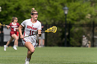 NEWTON, MA - MAY 14: Kaitlyn Cerasi #11 of University of Massachusetts brings the ball forward during NCAA Division I Women's Lacrosse Tournament first round game between University of Massachusetts and Temple University at Newton Campus Lacrosse Field on May 14, 2021 in Newton, Massachusetts.