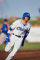 Paulo Orlando (22) of the Omaha Storm Chasers hustles toward third base during the game against the Round Rock Express at Werner Park on May 27, 2018 in Papillion , Nebraska. Round Rock defeated Omaha 8-3. (Stephen Smith/Four Seam Images)