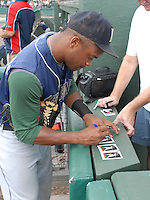 Infielder Delino DeShields Jr. (2) of the Lexington Legends signs autographs prior to a game against the Greenville Drive on August 5, 2011, at Fluor Field at the West End in Greenville, South Carolina. (Tom Priddy/Four Seam Images)