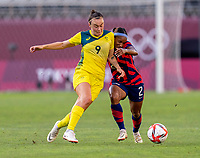KASHIMA, JAPAN - AUGUST 5: Caitlin Foord #9 of Australia fights for the ball with Crystal Dunn #2 of the USWNT during a game between Australia and USWNT at Kashima Soccer Stadium on August 5, 2021 in Kashima, Japan.